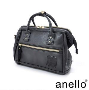 Anello faux leather hand purse
